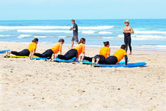 VALE FIGUEIRAS, PORTUGAL - August 22 2014: Surfers doing excersi Stock Photos