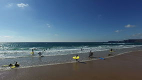 Vale Figueiras, Portugal - July 21, 2015: Surfing school on the beach at Figueiras stock video footage