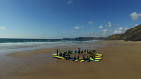 Vale Figueiras, Portugal - July 21, 2015: Surfing school on the beach at Figueiras. Teaches hopeful surfers the tricks of the surfer sport. Vale Figueiras is a stock video