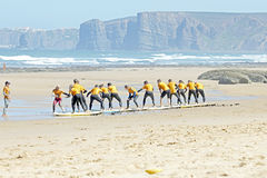 VALE FIGUEIRAS, PORTUGAL - Surfers doing excersises. VALE FIGUEIRAS, PORTUGAL - August 29 2014:  Surfers doing excersises on the famous surfers beach Vale Stock Images