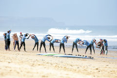 VALE FIGUEIRAS, PORTUGAL - Surfers doing excersises. VALE FIGUEIRAS, PORTUGAL - August 16 2014:  Surfers doing excersises on the famous surfers beach Vale Royalty Free Stock Images