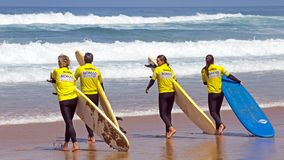 VALE FIGUEIRAS, PORTUGAL - 20th AUGUST 2017: Surfers getting sur. Fers lessons at Vale Figueiras beach in Portugal on august 20, 2017 Stock Photo