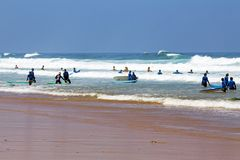 VALE FIGUEIRAS, PORTUGAL - 20th AUGUST 2017: Surfers getting sur. Fers lessons at Vale Figueiras beach in Portugal on august 20, 2017 Stock Photography