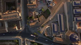 Valencia aerial view, Spain. Flying over the green park with paths, houses with rooftops and cars on the roads in Valencia, Spain stock video