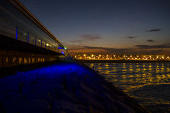 Valencia beach at night, seen from the harbor, Spain Royalty Free Stock Images