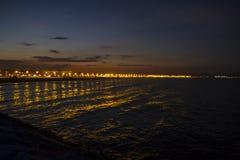 Valencia beach at night, seen from the harbor, Spain Royalty Free Stock Photos