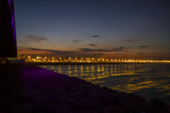 Valencia beach at night, seen from the harbor, Spain Royalty Free Stock Photography