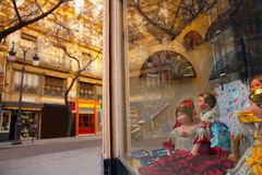 Valencia Calle san Vicente with Falleras dolls and spanish fan Stock Photo