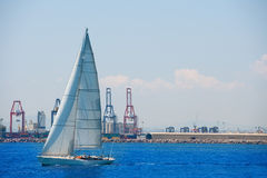 Valencia city port with sailboat and cranes in background Stock Photos