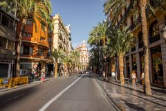 Valencia city in Spain. Street view with beautiful luxurious building and palm trees in Valencia city during the sunny day in Spain Stock Photo