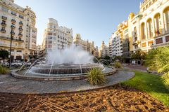 Valencia city in Spain. View on the Ayuntamiento square with fountain and beautiful buildings in Valencia city in Spain Stock Images
