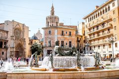 Valencia city in Spain. View in the Virgen square with cathedral and fountain in the centre of Valencia city during the sunny day in Spain Royalty Free Stock Image