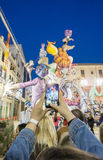 Valencia in Fallas 2015, Les Falles by phone. VALENCIA, SPAIN - MARCH 15: Unidentified tourist takes photo with mobile phone of El Pilar falla Las Fallas (the Royalty Free Stock Images