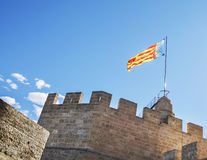 Valencia flag flying from the top of Serranos Towers, Valencia, Spain Royalty Free Stock Photos