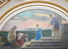 Valencia - Fresco of Jesus as a Child at the Temple in Jerusalem. Fresco of Jesus as a Child at the Temple in Jerusalem, with Mother Mary and Joseph royalty free stock image