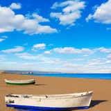 Valencia La Malvarrosa beach boats stranded. In Mediterranean Spain Royalty Free Stock Photography