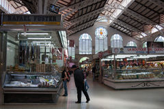 Valencia - Mercado Central. Valencia, Spain - May 22, 2012: Central market hall, Mercado Central. To found some sort of raw ingredient  like meat, cheeses Royalty Free Stock Images