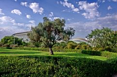 Valencia, near the City of arts and sciences. View of the park that is closed to two of the main buildings of the City of arts and sciences (Ciudad de las Royalty Free Stock Images
