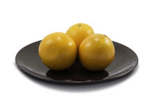 Valencia orange on brown plate and white background Stock Images