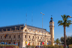 Valencia Port building with tower and palm tree Royalty Free Stock Photography