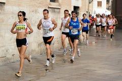 Valencia Run. VALENCIA, SPAIN - JULY 4: Runners compete in the I Volta a Peu de les Falles de Valencia 6 km run on July 4, 2010 in Valencia, Spain stock photography