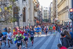 VALENCIA, SPAIN - DECEMBER 02: Runners compete in the XXXVIII Valencia Marathon on December 18, 2018 in Valencia, Spain royalty free stock photos