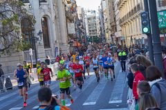 VALENCIA, SPAIN - DECEMBER 02: Runners compete in the XXXVIII Valencia Marathon on December 18, 2018 in Valencia, Spain royalty free stock images