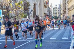 VALENCIA, SPAIN - DECEMBER 02: Runners compete in the XXXVIII Valencia Marathon on December 18, 2018 in Valencia, Spain stock photography