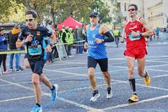 VALENCIA, SPAIN - DECEMBER 02: Runners compete in the XXXVIII Valencia Marathon on December 18, 2018 in Valencia, Spain.  royalty free stock photo