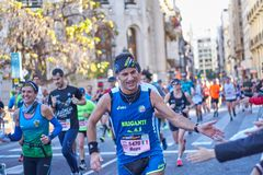 VALENCIA, SPAIN - DECEMBER 2: Runners shake hands with attendees at the XXXVIII Valencia Marathon on December 18, 2018 in Valencia stock photos
