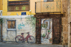 VALENCIA, SPAIN - FEBRUARY 3, 2016: Graffity with a bicycle and an old door at the street of old town of Valencia city, Costa Blan Royalty Free Stock Images