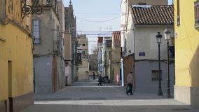Street with old houses and few people in Valencia, Spain. Valencia, Spain - January 13, 2018: View to Barraca street. Some people walking in the alleyway between stock video
