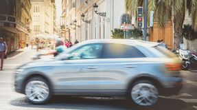 Car is driving fast on a pedestrian crossing. VALENCIA, SPAIN - June 16, 2017 : car is driving fast on a pedestrian crossing near a pedestrian zone on a summer stock images