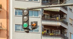 Traffic light green with yellow arrow on right Stock Image