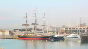 Valencia, Spain, 2018-09-12: A large sailing ship is in the port of Valencia. Morning in the port, the ships are parked.  stock video