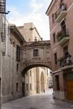 Arch in Calle de la Barchilla, between the cathedral and the arc Stock Photos