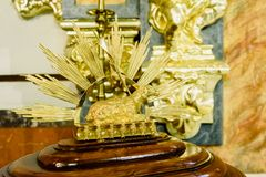Valencia, Spain - May 6, 2019: Religious statue of a golden calf inside a church