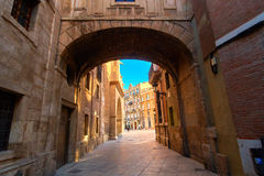 Valencia Spain Narrow Street with Arch Bridge Stock Photography