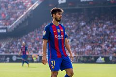 Andre Gomes plays at the La Liga match between Valencia CF and FC Barcelona at Mestalla. VALENCIA, SPAIN - OCT 22: Andre Gomes plays at the La Liga match between royalty free stock photo