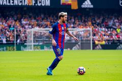 Leo Messi plays at the La Liga match between Valencia CF and FC Barcelona at Mestalla. VALENCIA, SPAIN - OCT 22: Leo Messi plays at the La Liga match between stock images
