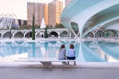 Two women chatting at the City of Arts and Sciences in Valencia, Spain stock photography