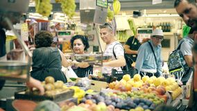 VALENCIA, SPAIN - SEPTEMBER 22, 2018. Customers buy fruit at stall of famous Mercado Central or Central Market. VALENCIA, SPAIN - SEPTEMBER 22, 2018 Customers royalty free stock photography