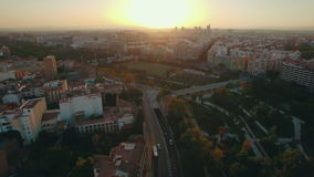 Valencia at sunset, aerial view. Aerial cityscape of Valencia at sunset, Spain. City panorama with houses, transport traffic and green parks with sports grounds stock video