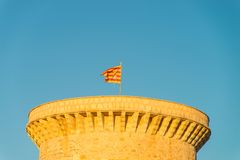 Valencian flag on top of a watchtower Stock Images