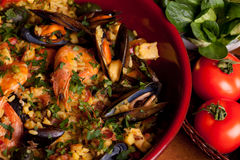 Valencian Paella. Terracotta pan with Valencian typical paella Stock Photo