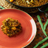 Valencian Paella with chicken and rabbit Stock Photo