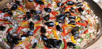 Valencian Paella rice with clams and mussels Stock Photo