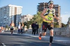 Valencias Marathon. VALENCIA - NOVEMBER 17: Dario Sanmiguel Cervera  (number 284) participates in Valencias marathon on November 17, 2013 in Valencia, Spain Royalty Free Stock Photos