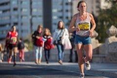 Valencias Marathon. VALENCIA - NOVEMBER 17: Yulia Esmirnova  (number 108) participates in Valencias marathon on November 17, 2013 in Valencia, Spain Royalty Free Stock Images