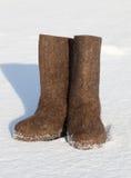Valenki on white snow Stock Photo